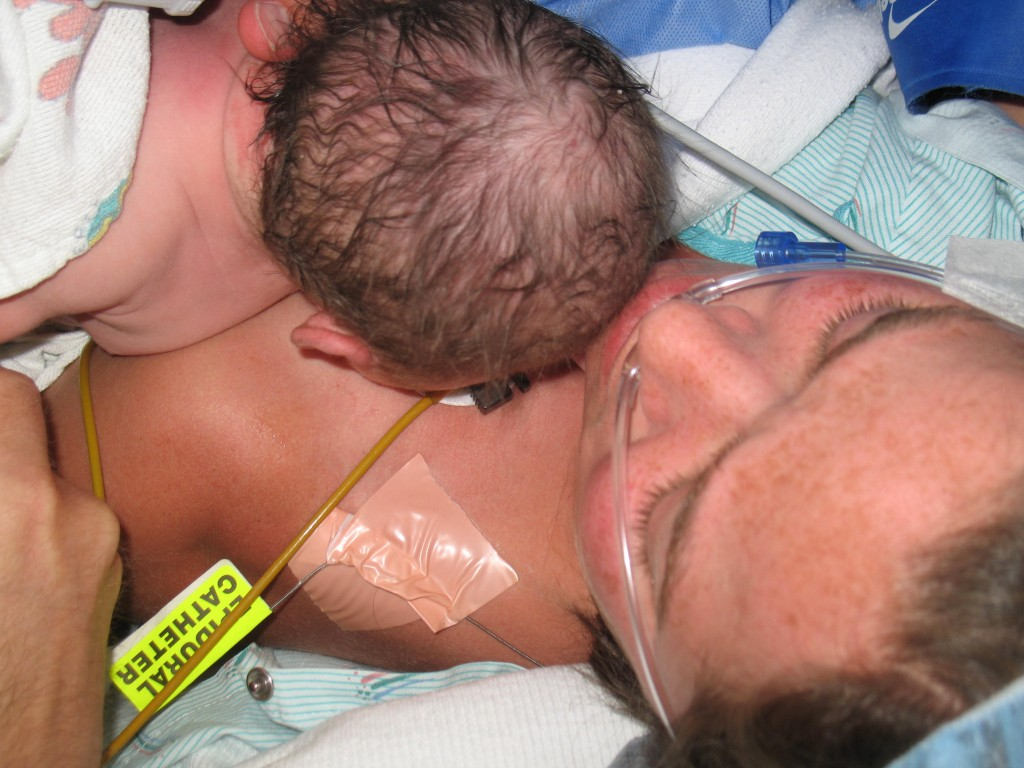A mother does skin-to-skin with her newborn in the operating room (wishes to remain anonymous).