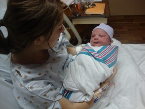 Bridget and her 11 pound son shortly after birth. Bridget was GBS positive and had 2 doses of antibiotics through a heplock. In between doses she was unhooked from the IV pole.